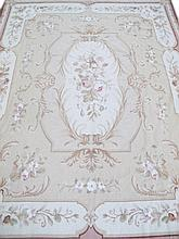 NEEDLEPOINT HANDMADE RUG.  20th century.  Shades of tans and biege with floral s
