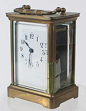 FRENCH H&H; CARRIAGE CLOCK. With porcelain face,