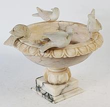 CARVED ALABASTER BIRDBATH. With four birds