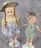 TWO VINTAGE COMPOSITION DOLLS.  On stands.