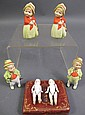 FOUR COLORED ALL BISQUE DOLLS. With moveable