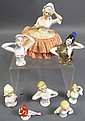 EIGHT CHINA PIN CUSHION DOLLS. Including one