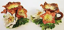 PAIR OF CONTINENTAL FAIENCE FLORAL CHAMBERSTICKS.  Ca. 1920.