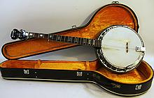 ORPHEUM FIVE STRING BANJO.  Fairly recent with exotic hardwood construction, met al resonator and pearl inlaid head, neck and back of body, clean in a luggage case.