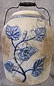 BLUE AND GREY STONEWARE JAR.  With raised flowers and a bail handle.  11