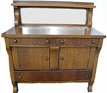 GOLDEN OAK EMPIRE STYLE SIDEBOARD WITH MIRROR BACKSPLASH/SHELF.  Quarter sawn veneers, cabinets and drawers.  Ca. 1910.  50