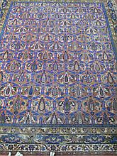 ORIENTAL STYLE MACHINE WOVEN ROOM SIZE RUG.  With brick red ground and blue outlined repearting designs.  Approx. 9'7