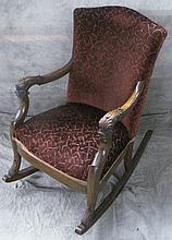 SCULPTURED MOHAIR PARLOR ROCKING CHAIR.  Ca. 1910.  With carved stylized dolphinface arm stumps.  (Note:  slight wear to upholstery).