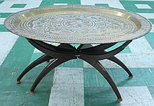 ENGRAVED BRASS OVAL COFFEE TABLE.  With base.