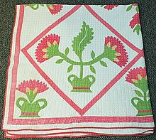 19TH CENTURY APPLIQUE QUILT.  PA Dutch traditional designs of single flowers in