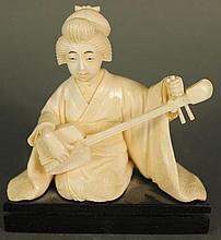 JAPANESE GEISHA IVORY CARVING.  Seated, playing a samisen.  Ca. 1930.  4 1/2
