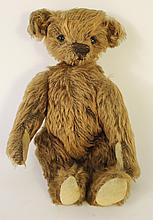 MOHAIR TEDDY BEAR WITH MOVEABLE ARMS AND LEGS.  First 1/2 20th century.  10