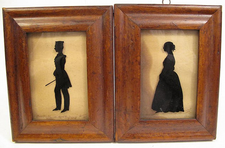 PAIR OF ANTIQUE REVERSE ON GLASS SILHOUETTES.