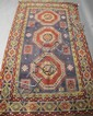 TWO ORIENTAL RUGS. Including a Turkish geometric