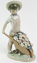 LLADRO PORCELAIN FIGURE. Boy with flower filled