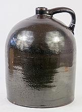 FIVE GALLON STONEWARE JUG. With iron glaze. 19th