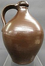 FINE, SMALL OVOID IRON RED GLAZED JUG. American.