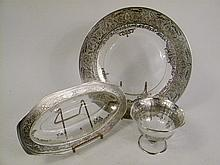 THREE ORNATED SILVER OVERLAY SERVING PIECES.