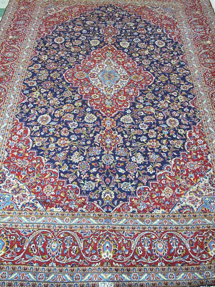 PERSIAN KASHAN RUG.  Approx. 13' x 9'.