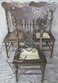 FIVE AMERICANN PRESSED BACK CHAIRS. With lions