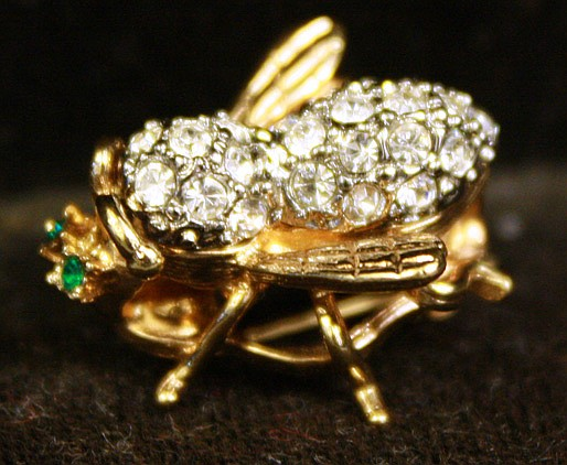 GOLD AND DIAMOND BEE PIN. With green eyes.
