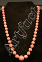 14K GOLD MOUNTED CORAL BEADS.