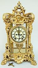 ANSONIA PALACE CLOCK.  Bronze finish Louis XV rococo scroll case with porcelain