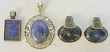 COLLECTION OF FOUR CHINESE LAPIS PENDANTS.  In silver metal mountings.