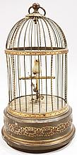 SINGING BIRD IN BRASS CAGE.  Complete with operating movements of bird.  Made in
