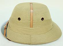 PITH HELMET.  Mid 20th century.  The favorite tropical head gear of the British