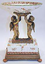 ITALIANATE BRONZE AND EARTHENWARE CLASSICAL STYLE COMPOTE.  With two cherubs sup
