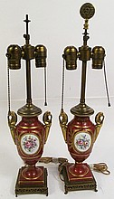 PAIR OF FRENCH SEVRES TYPE HAND PAINTED PORCELAIN URNS MOUNTED AS LAMPS.  With c ustom bronze mounts.  12