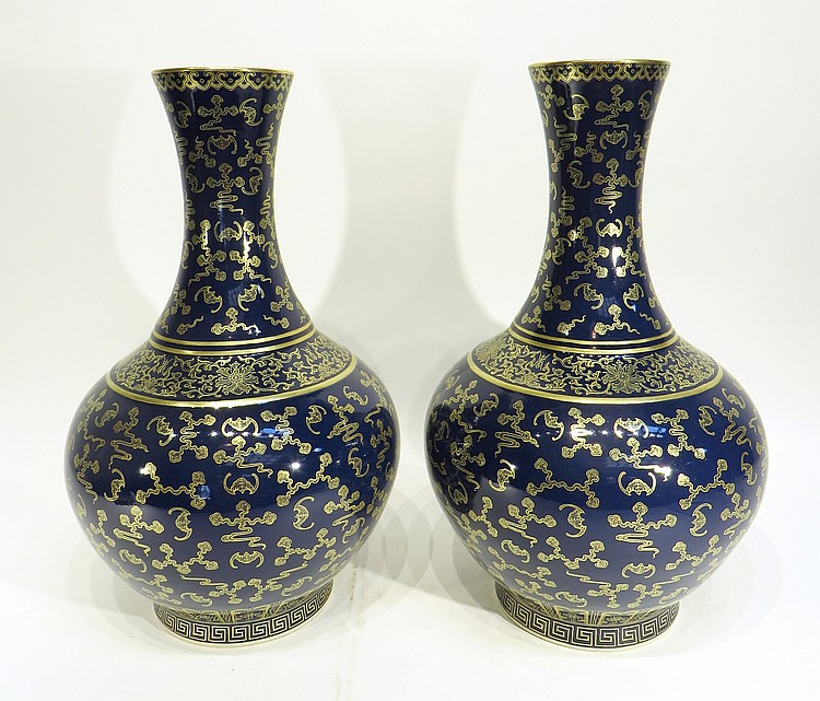 PAIR OF CHINESE GILT ON BLUE PORCELAIN VASES