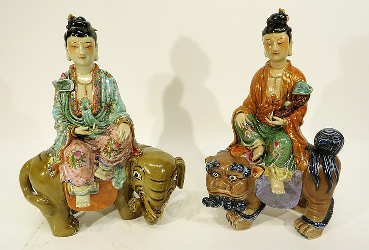 PAIR OF CHINESE PORCELAIN BUDDHA'S RIDING ANIMALS