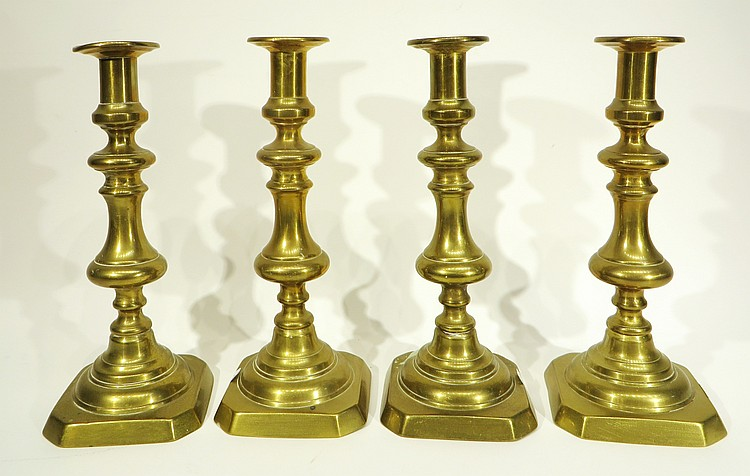 FOUR MATCHING ANTIQUE CAST BRASS CANDLESTICKS