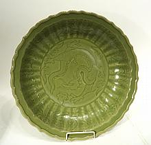 LARGE CARVED 'PEONY' LONGQUAN CELADON CHARGER