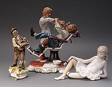 BISQUE DENTIST SCENE & TWO OTHER FIGURINES