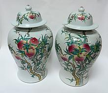 PAIR OF CHINESE PEACHES & BATS LIDDED JARS