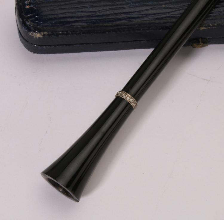 Cigarette Diamond: BLACK BAKELITE AND DIAMOND CIGARETTE HOLDER