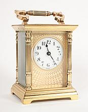 French brass and beveled glass carriage clock