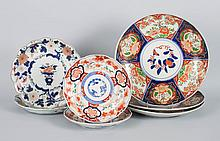 Seven Japanese Imari plates and chargers