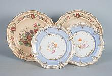 Two pairs of floral decorated china plates