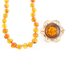 A Strand of Amber Beads and Amber Brooch