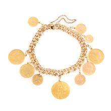 A Lady's 18K Charm Bracelet with Assorted Coins
