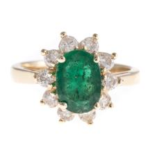 A Lady's Emerald and Diamond Ring in Gold
