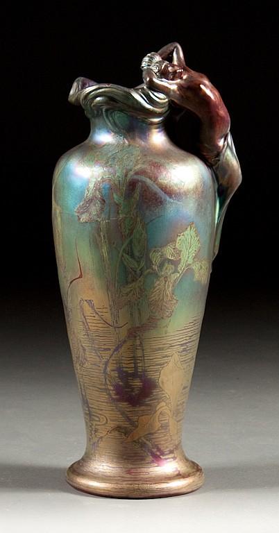 Delphin Massier Art Nouveau iridescent glazed pottery figural vase