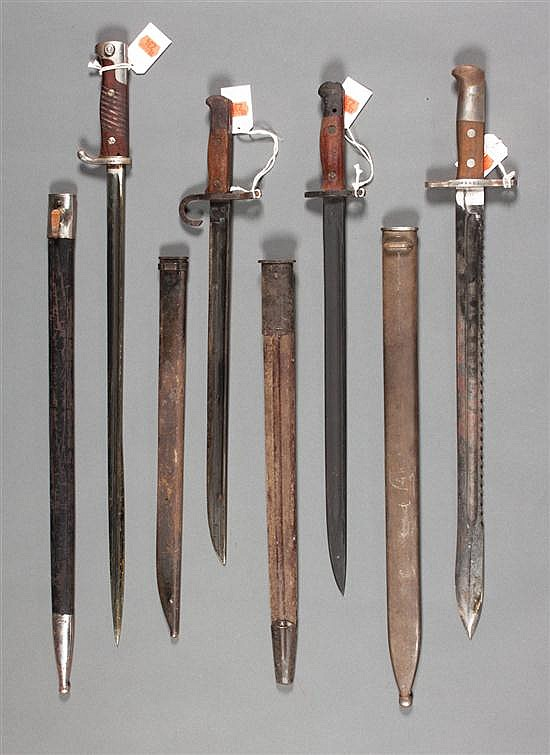 Four German bayonets and scabbards, early 20th century