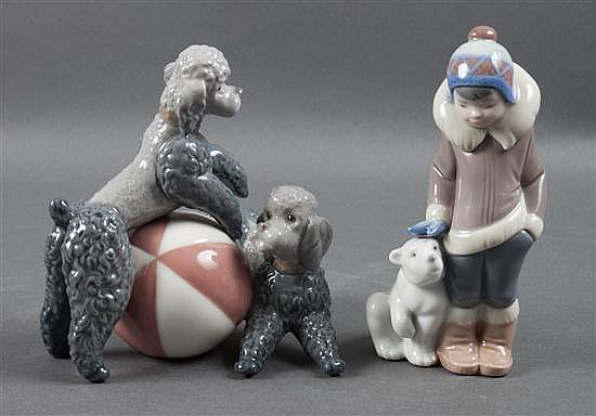Lladro porcelain figural group of two poodles playing with ball, and Eskimo boy with pet polar bear