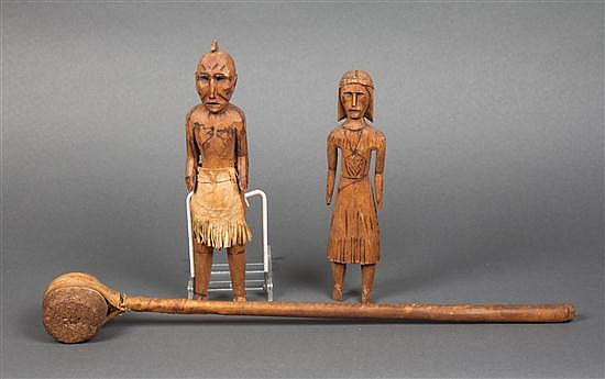Pair of Native American style figural wood carvings of a man and woman, together with a stone, wood, and rawhide club, early 20th c.