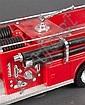 Hess fire pumper truck with original box, and a Hess fire engine ladder truck